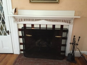 Another tiled fireplace, with the inscription,