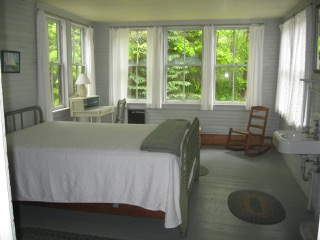 Anchorage, ground floor back bedroom with bay windows and heater