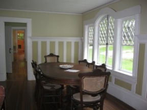 Anchorage, dining room table and view of west wing hallway all the way to the 3/4 bath at the end